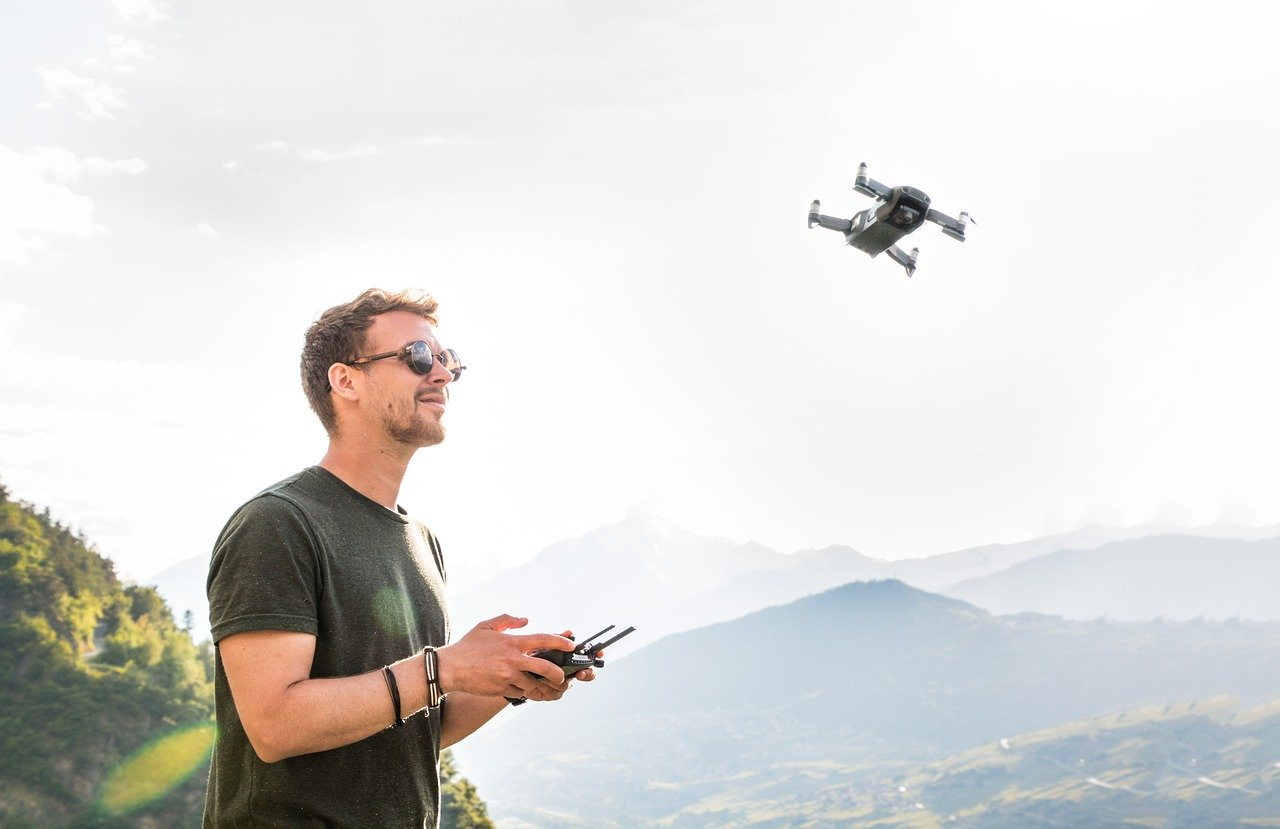 A Man Piloting A Drone